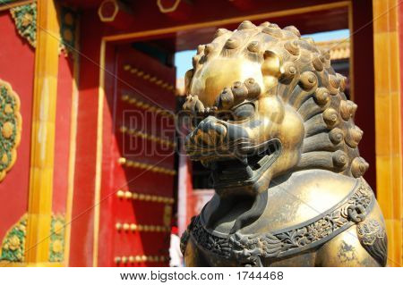 Chinese Lion Statue Guards Red Gate
