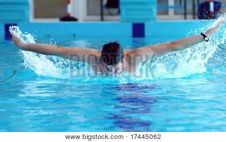 Swimmer swimming in the waterpool