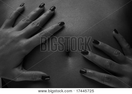 woman holding hands on her stomach
