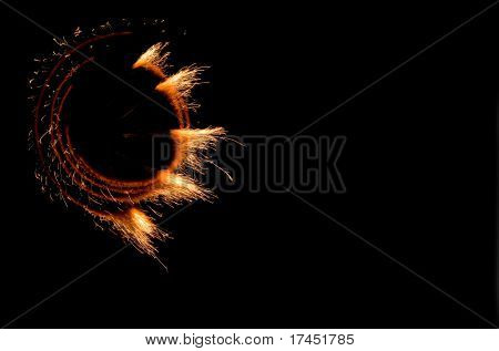 Fires of pyrotechnics on a black background.