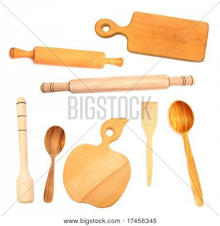 Set of wooden kitchen utensils isolated on white