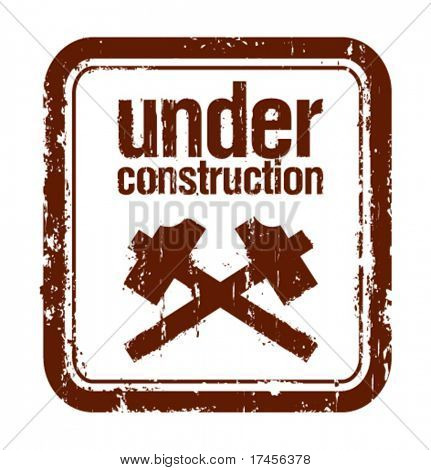 under construction grunge rubber stamp with two hammers