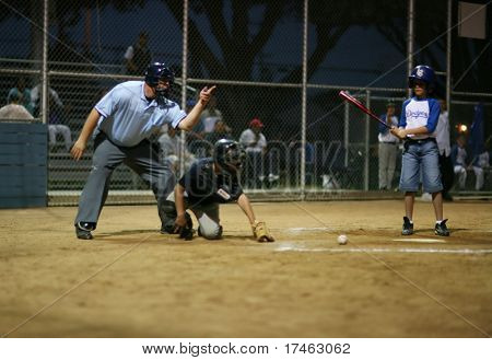 Young Batter Striking Out
