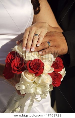 Wedding Rings atop the Bridal Boquet