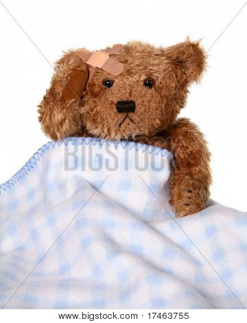 Sick Brown Teddy Bear Holding Injured Head