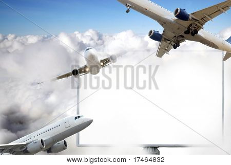 Airplane in the sky with big billboard