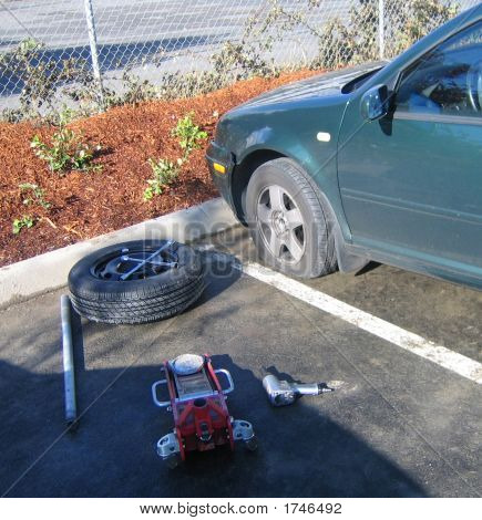 Flat Tire With Spare And Tools