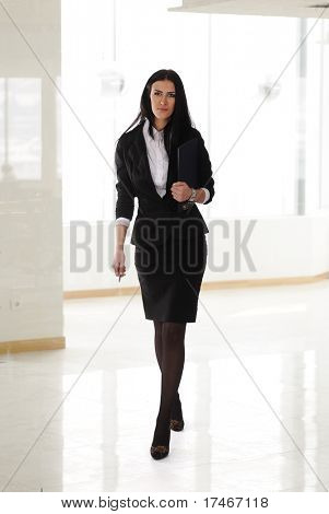 Young brunette businesswoman celebrate  cheerful person