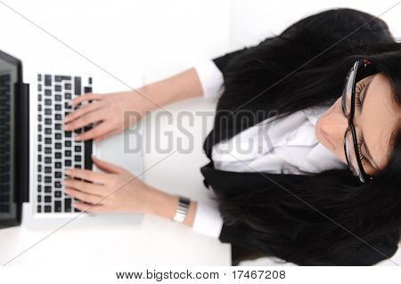 beautiful secretary  typing on the laptop, different angle of photo