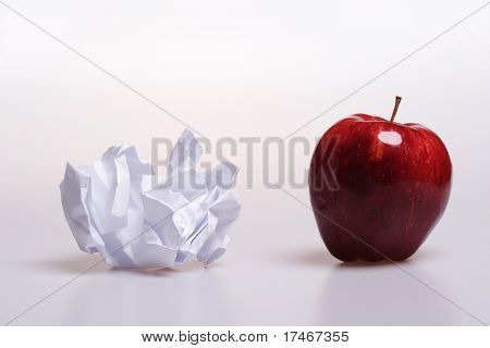 Crumple paper and red apple with reflection