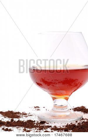 Brandy and scattering coffee isolated on white background