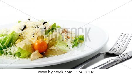 Caesar Salad Comprises Romaine Lettuce and Croutons Dressed with Parmesan cheese. Isolated on White Background