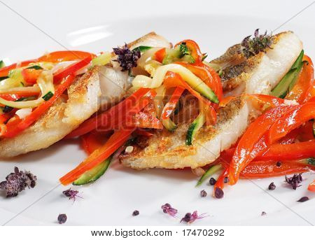 Grilled Fish with Julienne Vegetable. Isolated on White Background