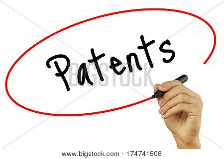 Man Hand Writing Patents With Black Marker On Visual Screen. Isolated On Background. Business, Techn
