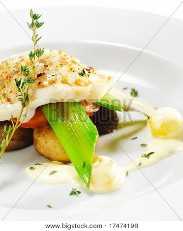 Hot Fish Dishes - Halibut fillet with Mushrooms, Tomatoes and Bacon