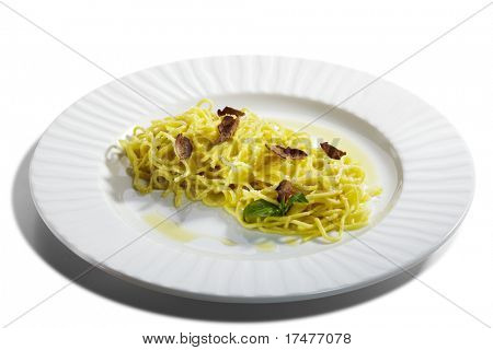 Home made Pasta with Parmesan Cheese and Tartufo Bianco (white truffle). Served with Basil Leaf