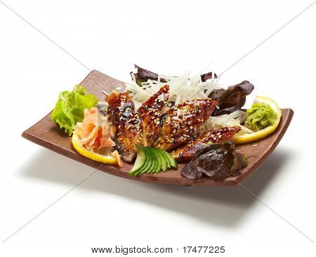 Unagi Sashimi - Smoked Eel on Daikon (White Radish) with Eel Sauce and Sesame. Garnished with Ginger, Wasabi, Seaweed, Cucumber, Salad Leaf and Lemon