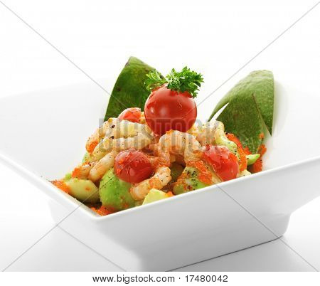 Salad with Avocado, Shrimps, Flying Fish Roe, Kiwi Sauce and Herbs. Isolated over White