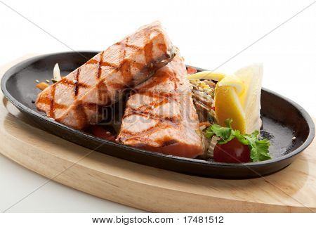 Grilled Foods - Salmon Steak with Vegetables. Garnished with Lemon and Parsley