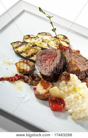 Prime Veal with Risotto, Tartufo Nero (Black Truffle), Zucchini Grill, Porcini and Dried Tomato