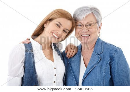 Portrait of happy young woman and senior mother smiling over white background.?