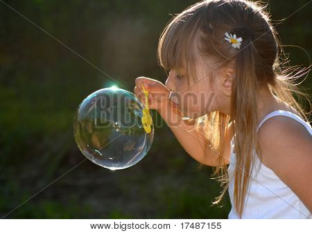 Little girl playing in the garden