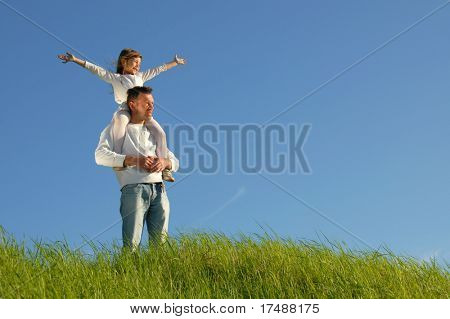 Father gives her daughter piggyback