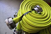 stock photo of firehose  - Firehose rolled up to be used by Firefighters - JPG