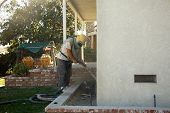 foto of sandblasting  - Home Being Sandblasted in a Residential Area - JPG