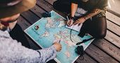 Tourist Planning Vacation Using World Map. poster