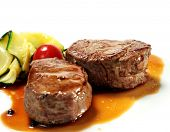 stock photo of veal  - Veal Medallions with Zucchini and Cherry Tomato - JPG
