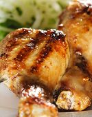 Grilled Chicken Legs on Skewer with Pickled Onions and Salad Leaf