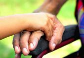 picture of disabled person  - little girl holding hard a handicapped man - JPG