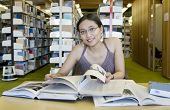 stock photo of asian woman  - asian woman studying in the library - JPG