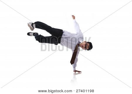 Asian Man With Acrobatic Kick Isolated On White