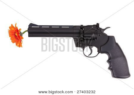 Orange Flower Hanging From The Gun Barrel