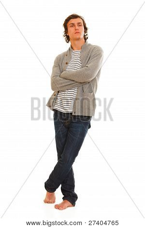 Full Length Portrait Of Young Man Posing On White Background