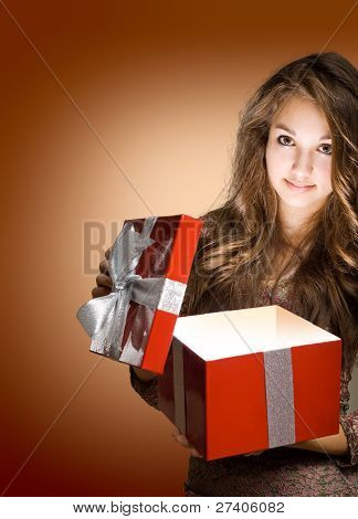 Young Brunette With Big Red Gift Box.