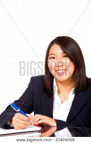 Asian Businesswoman Writing
