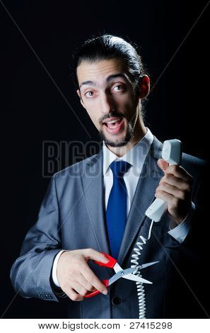 Man cutting the phone cable