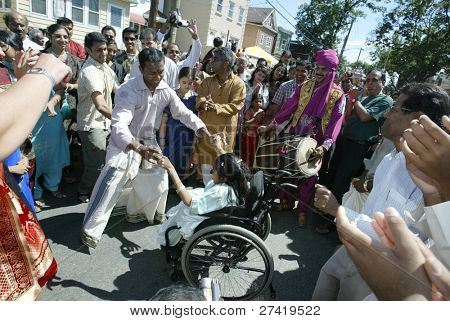 NEW YORK - AUGUST 30:  Hindus dance as they celebrate the birth of Ganesh, mythical god of new endeavors, at the Sri Ganesa Chaturthi event August 30, 2003 in Flushing, New York.