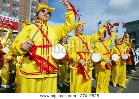 FLUSHING, NY - FEBRUARY 12:  Falun Gong members beat drums as they participate in Chinese New Year celebrations February 12, 2005 in the Flushing neighborhood of New York City.