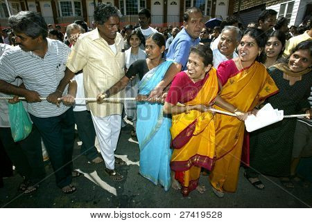NEW YORK - AUGUST 30:  Hindus attend the celebration of the birth of Ganesh, mythical god of new endeavors, at the Sri Ganesa Chaturthi event August 30, 2003 in Flushing, New York.