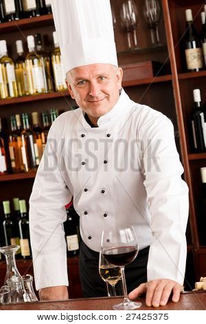 At the bar - senior barman chef standing wine degustation