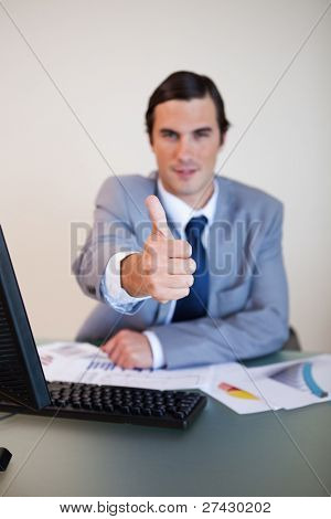 Thumb up given by sitting businessman