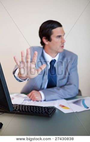 Hand used by businessman to reject something