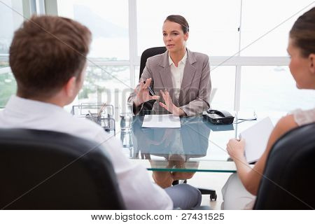 Lawyer explaining legal situation to her clients