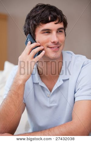 Young man answering phonecall