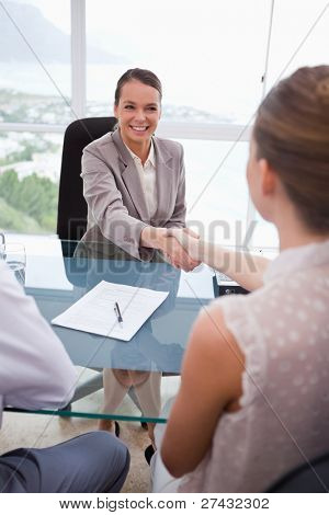 Business partners shaking hands after signing contract