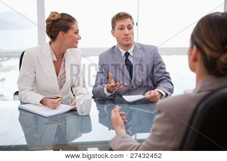 Business partners talking with their lawyer